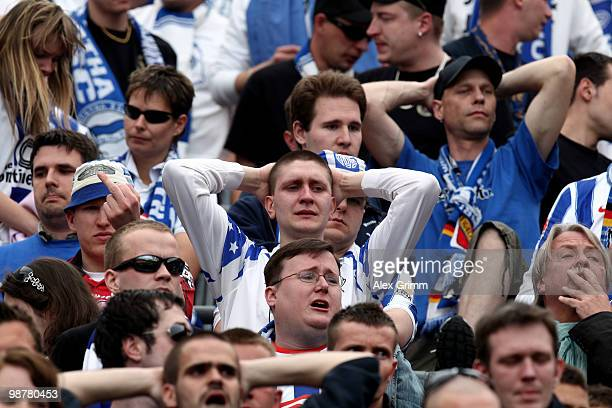 Supporters of Berlin react after the Bundesliga match between Bayer Leverkusen and Hertha BSC Berlin at the BayArena on May 1, 2010 in Leverkusen,...