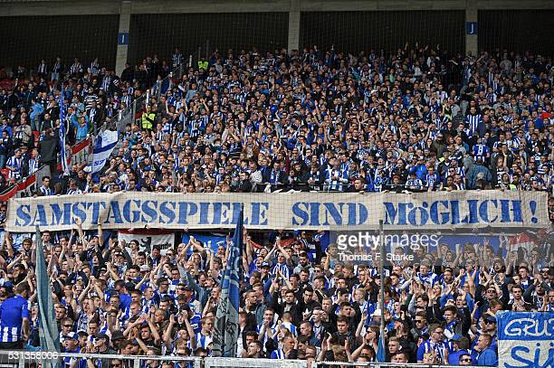Supporters of Berlin show a banner against monday games during the Bundesliga match between 1 FSV Mainz 05 and Hertha BSC at Coface Arena on May 14...