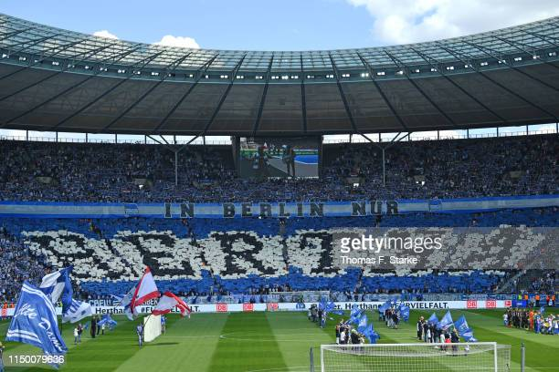 Supporters of Berlin show a choreography during the Bundesliga match between Hertha BSC and Bayer 04 Leverkusen at Olympiastadion on May 18, 2019 in...