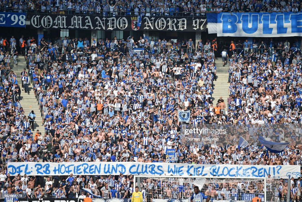 Supporters of Berlin show a protest banner against the German Football League (DFL) during the Bundesliga match between Hertha BSC and RB Leipzig at Olympiastadion on May 12, 2018 in Berlin, Germany.