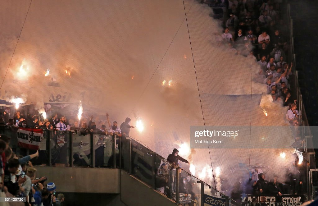 Supporters of Berlin use pyrotechnical articles during the DFB Cup first round match between FC Hansa Rostock and Hertha BSC at Ostseestadion on August 14, 2017 in Rostock, Germany.