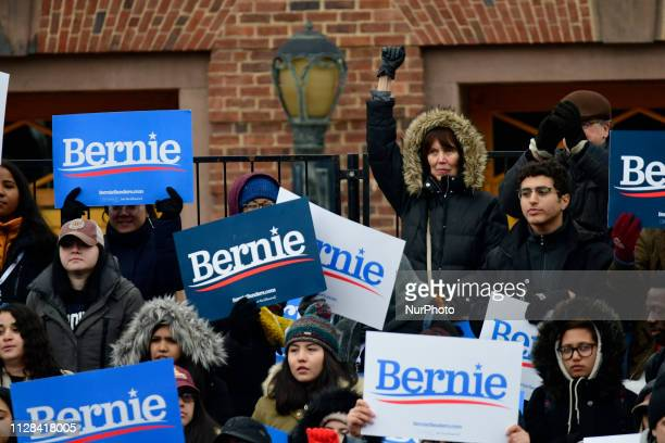 Supporters of Bernie Sanders hold up signs as the Independent US Senator from Vermont kicksoff his campaign for the 2020 US Presidential Elections on...
