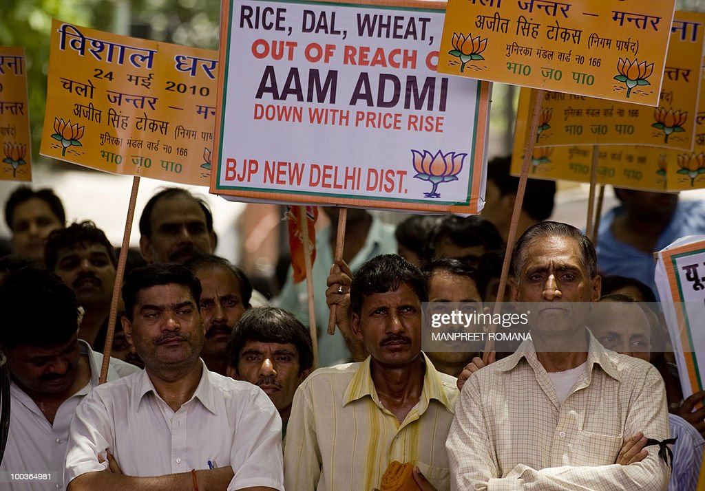 Supporters of Bharatiya Janata Party (BJP) hold placards during a protest in New Delhi on May 24, 2010. Opposition BJP members and supporters held a sit-in protest in the nation's capital in observation of a 'black day' over the rising prices of essential commodities. AFP PHOTO/ Manpreet ROMANA