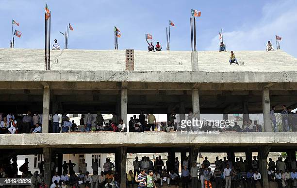 Supporters of Bharatiya Janata Party listening their Party President Rajnath Singh during an election campaign rally on April 15 2014 at Udhampur...