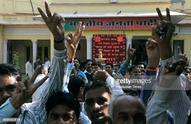 Supporters of Bharatiya Janta Party celebrate party's clear majority win in Local Body Polls in five out of six boards in the backdrop of a digital...
