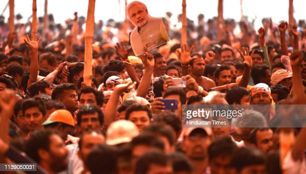 Supporters of Bhartiya Janata Party during an election campaign rally of Prime Minister Narendra Modi at Ilambazar, near Bolpur, on April 24, 2019 in...
