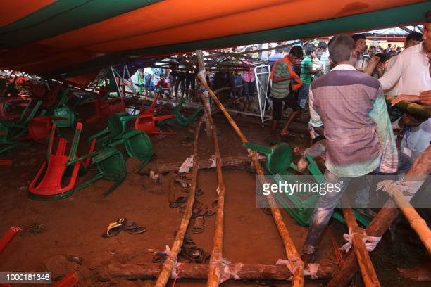 Supporters of Bhartiya Janta Party look inside a damaged tent which collapsed during a public meeting addressed by India's Prime Minister Narendra...