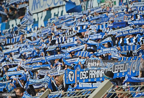 Supporters of Bielefeld cheer their team during the Second Bundesliga match between Arminia Bielefeld and SV Sandhausen at Schueco Arena on October...