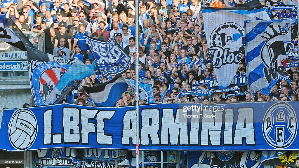 Supporters of Bielefeld cheer their team during the Third League match between MSV Duisburg and Arminia Bielefeld at Schauinsland-Reisen-Arena on August 27, 2014 in Duisburg, Germany.
