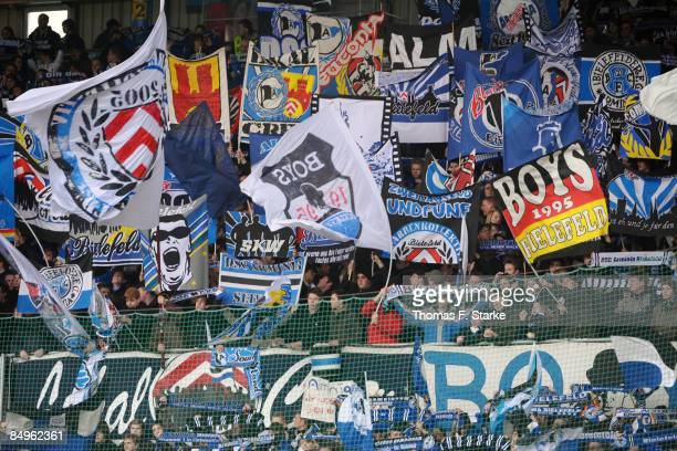 Supporters of Bielefeld cheer their team on prior to the Bundesliga match between Arminia Bielefeld and VfL Bochum at the Schueco Arena on February...