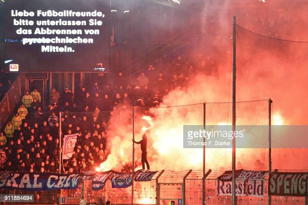 Supporters of Bielefeld fire smokebombs during the Second Bundesliga match between VfL Bochum 1848 and DSC Arminia Bielefeld at Vonovia Ruhrstadion...