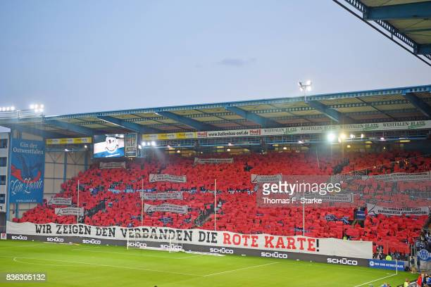 Supporters of Bielefeld show protest banners during the Second Bundesliga match between DSC Arminia Bielefeld and VfL Bochum 1848 at Schueco Arena on...