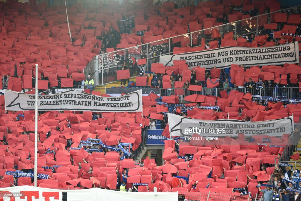 Supporters of Bielefeld show protest banners during the Second Bundesliga match between DSC Arminia Bielefeld and VfL Bochum 1848 at Schueco Arena on August 21, 2017 in Bielefeld, Germany.