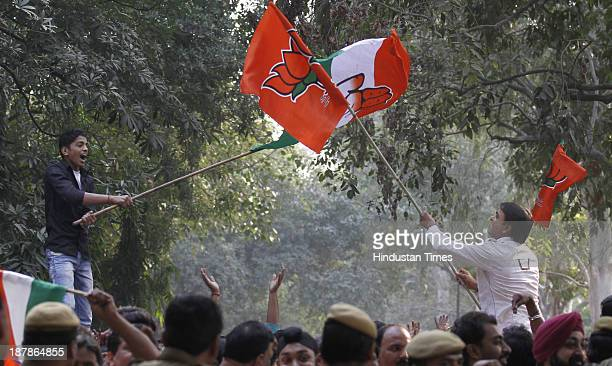 Supporters of BJP and Congress get into flag fight as the party candidates were filing their nomination papers at DC office Geeta Colony on November...