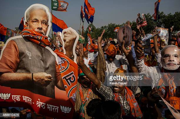 Supporters of BJP leader Narendra Modi cheer during his speech at a rally by the leader on May 8 2014 in Rohaniya near Varanasi India Thousands of...