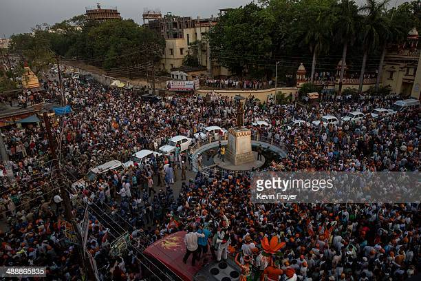 Supporters of BJP leader Narendra Modi crowd around Modi's convoy as it arrives on May 8 2014 in Varanasi India Thousands of supporters lined the...