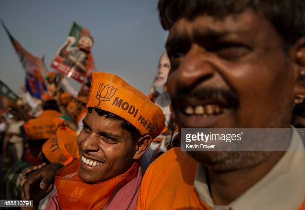 Supporters of BJP leader Narendra Modi listen during his speech at a rally by the leader on May 8 2014 in Rohaniya near Varanasi India Thousands of...