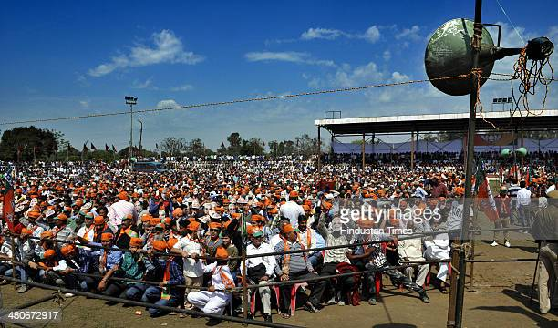 Supporters of BJP prime ministerial candidate Narendra Modi listening to their leader during a public rally at Heera Nagar on March 26 2014 about 60...