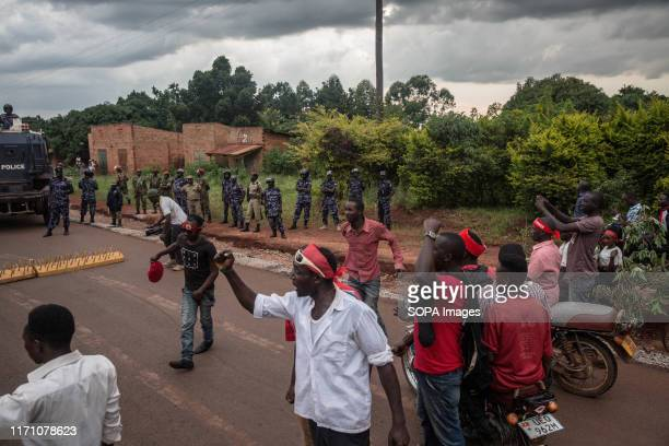 Supporters of Bobi Wine face down with police in Hoima. Wine aka Robert Kyagulanyi, campaigned in Hoima ahead of a by-election. It was the first time...