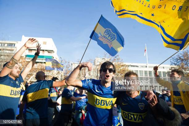 Supporters of Boca Juniors cheer at the team's Fan Zone in the Nuevos Ministerios area on Paseo de la Castellana south of the Santiago Bernabeu...