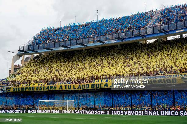TOPSHOT Supporters of Boca Juniors cheer before the start of the first leg match of the allArgentine Copa Libertadores final against River Plate at...