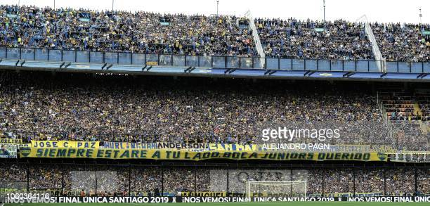 Supporters of Boca Juniors cheer during the first leg match of the allArgentine Copa Libertadores final against River Plate at La Bombonera stadium...