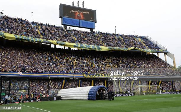 Supporters of Boca Juniors cheer for their team before the start of the first leg match of the allArgentine Copa Libertadores final against River...