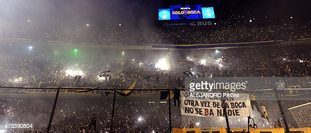 Supporters of Boca Juniors cheer their team before the Copa Libertadores 2015 quarterfinals second leg football match against River Plate at La...
