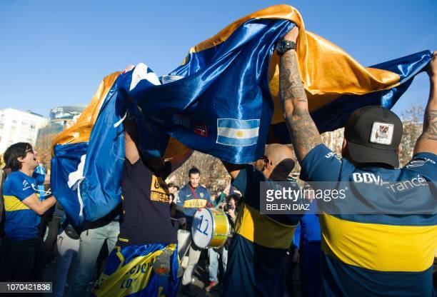 Supporters of Boca Juniors dance and cheer at the team's Fan Zone in the area around Nuevos Ministerios on Paseo de la Castellana south of the...