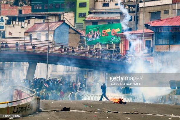 TOPSHOT Supporters of Bolivian exPresident Evo Morales and locals discontented with the political situation clash with riot police during a protest...