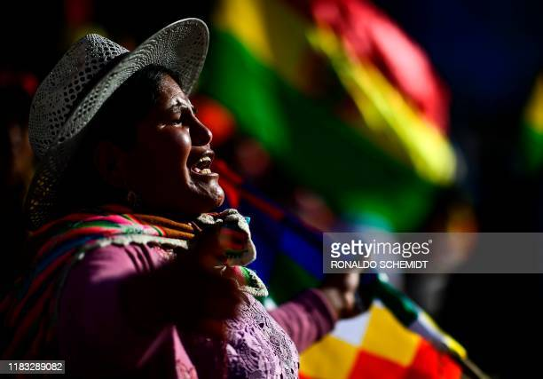 Supporters of Bolivian ex-President Evo Morales shout slogans during a demonstration in Cochabamba, on November 18, 2019. - Bolivia's interim...
