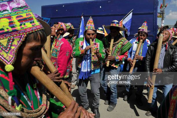 Supporters of Bolivian leftist presidential candidate Luis Arce of the Movimiento Al Socialismo , wait for his arrival to celebrate his victory of...