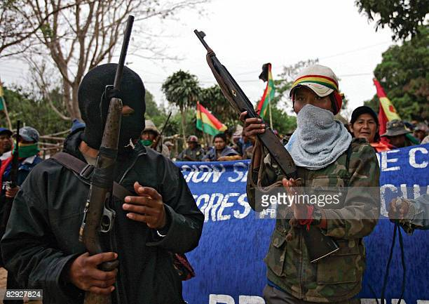 Supporters of Bolivian President Evo Morales carry rifles as they march in Buena Vista village 100km north of Santa Cruz Bolivia on September 20 2008...