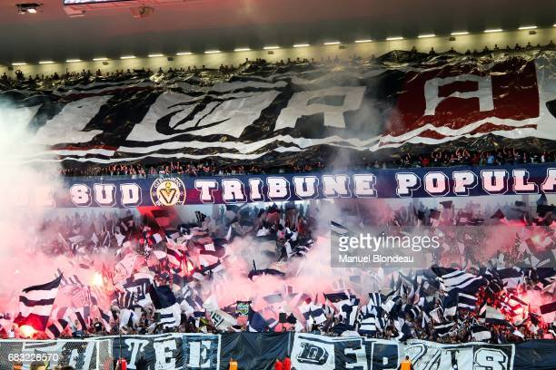 Supporters of Bordeaux wave flags and light flares ahead of the match during the Ligue 1 match between Girondins de Bordeaux and Olympique de...