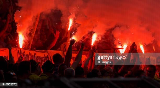 Supporters of Borussia Dortmund are firing Bengalos during the Bundesliga match between Borussia Dortmund and VfB Stuttgart at Signal Iduna Park on...