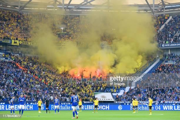 Supporters of Borussia Dortmund are seen during the Bundesliga match between FC Schalke 04 and Borussia Dortmund at VeltinsArena on October 26 2019...