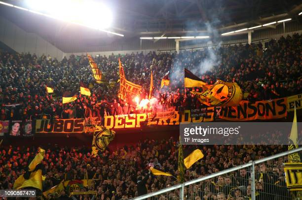 Supporters of Borussia Dortmund in the supporters' section light flares during the Bundesliga match between Fortuna Duesseldorf and Borussia Dortmund...