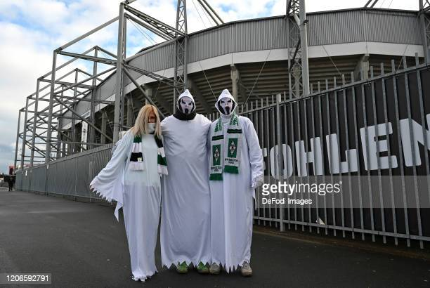 Supporters of Borussia Moenchengladbach dressed as a ghost pose prior to the Bundesliga match between Borussia Moenchengladbach and 1. FC Koeln at...