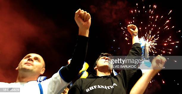 Supporters of Bosnia and Herzegovina's national football team celebrate the qualification of BosniaHerzegovina gathered late on October 15 at one of...