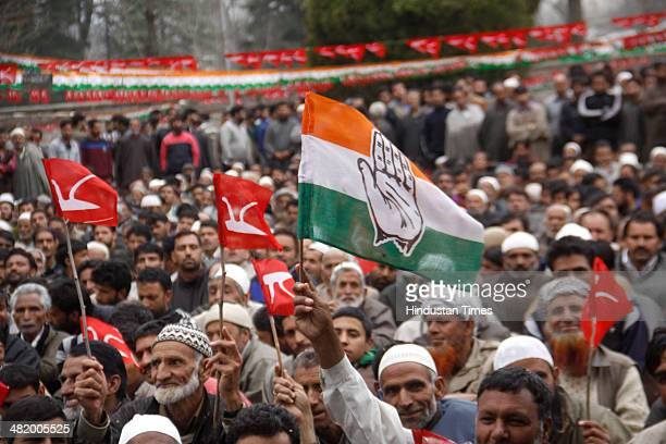 Supporters of both Congress and National Conference waving party flags during a rally held by National Conference Patron Farooq Abdullha and Jammu...