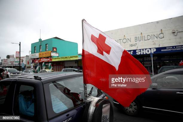 Supporters of both the Tongan and Samoan rugby league teams fly flags supporting their team in Onehunga on November 3 2017 in Auckland New Zealand...