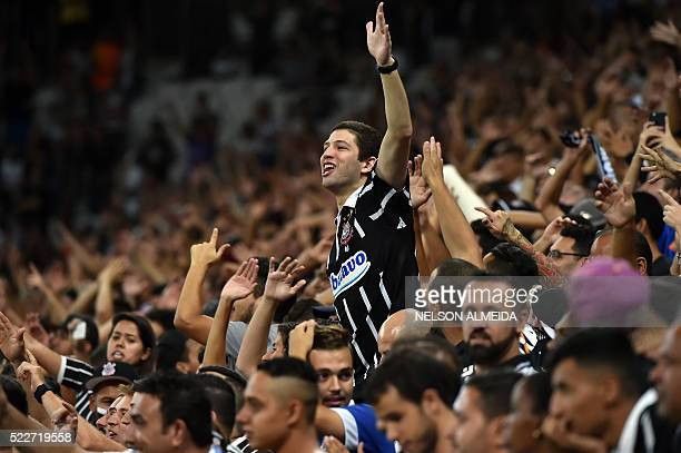 Supporters of Brazilian Corinthians cheer for their team during the 2016 Copa Libertadores football match against Chile's Cobresal held at Arena...