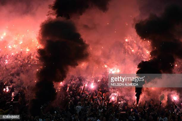 Supporters of Brazilian Corinthians cheer for their team during the 2016 Copa Libertadores football match against Uruguay's Nacional held at Arena...