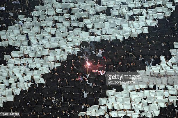 Supporters of Brazilian Corinthians cheer their team during the 2012 Copa Libertadores 2nd leg quarterfinal football match against Brazil's Vasco da...