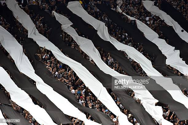 Supporters of Brazilian Corinthians cheer their team during the 2015 Copa Libertadores football match against Uruguay's Danubio held at Arena...