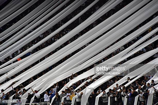 Supporters of Brazilian Corinthians cheer their team during the 2015 Copa Libertadores football match against Paraguay's Guarani held at Arena...