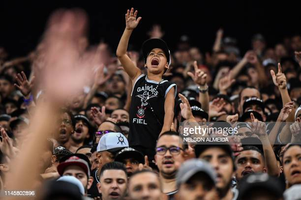 Supporters of Brazilian Corinthians cheer their team during the 2019 Copa Sudamericana football match against Venezuela's Deportivo Lara at Arena...