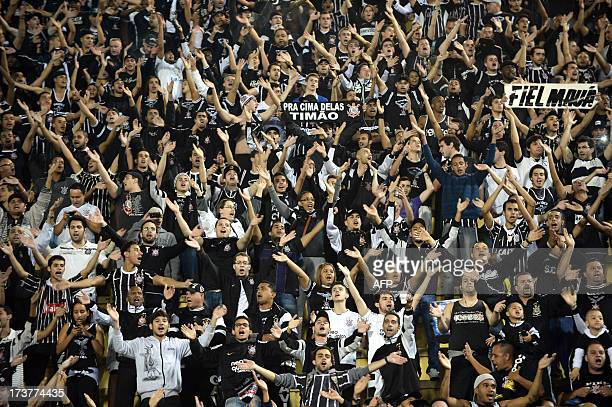 Supporters of Brazilian Corinthians cheer their team during the Recopa Sudamericana 2013 final football match against Brazil's Sao Paulo at Pacaembu...