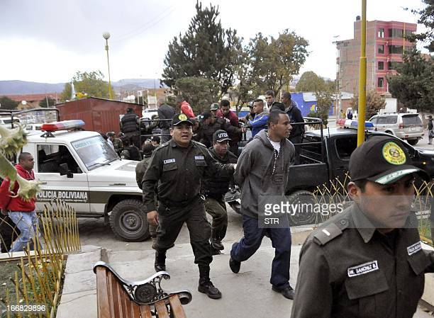 Supporters of Brazilian football team Corinthians are escorted as they enter San Pedro prison in Oruro Bolivia on April 17 2013 12 supporters of...