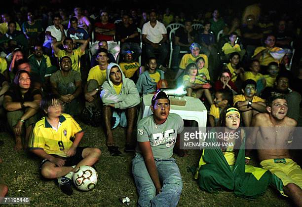 Supporters of Brazilian football team watch a world cup match between their former country and Croatia 13 June 2006 at Kibbutz Bror Chayil founded by...